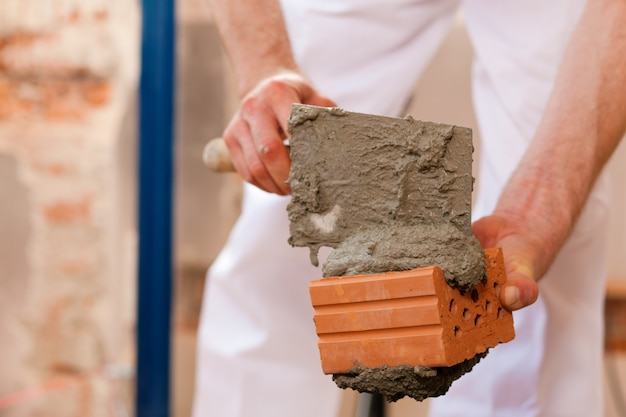 Bricklayer working on construction site