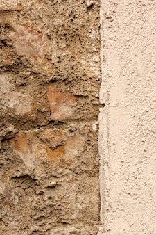 Bricks and concrete wall with rough surface