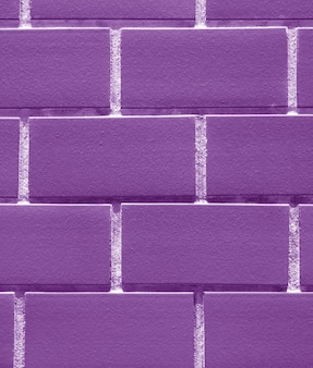 Bricks wall in purple color, vertical image for background
