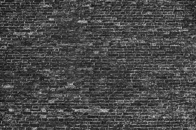 Кирпичная каменная стена из красных блоков фона для дизайна