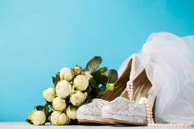 Bridal accessories composed together on blue
