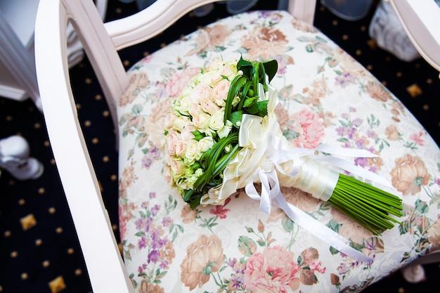 Bridal bouquet. the bride's bouquet lies chair