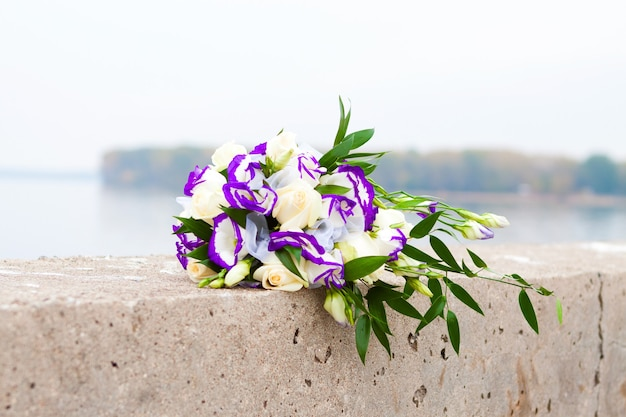Bridal bouquet of purple eustomas and white roses