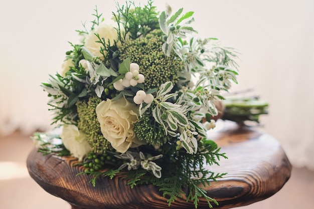 Bridal bouquet. wedding. wedding bouquet of white and green flowers stands on a chair