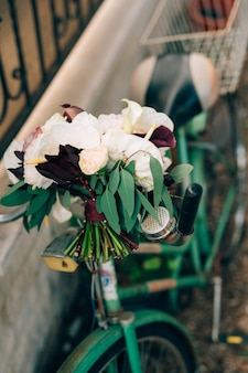 Bridal bouquet of white and pink peonies roses branches of eucalyptus tree calla lilies and