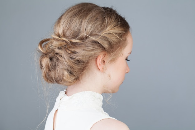 Bridal or prom hairstyle girl back view