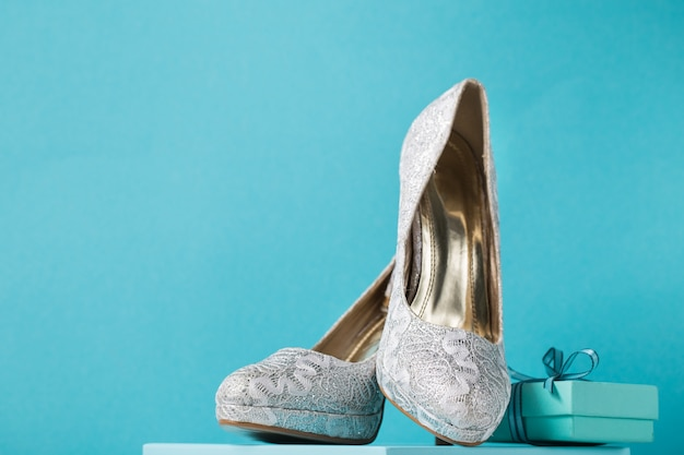 Bridal shoes on blue background