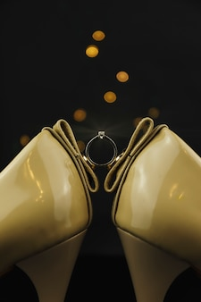 Bridal wedding high heel shoes and ring with diamond.