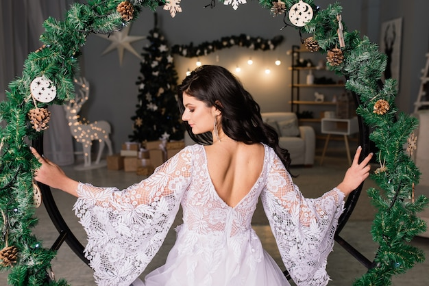 Bride on the background of new year lights, christmas interior