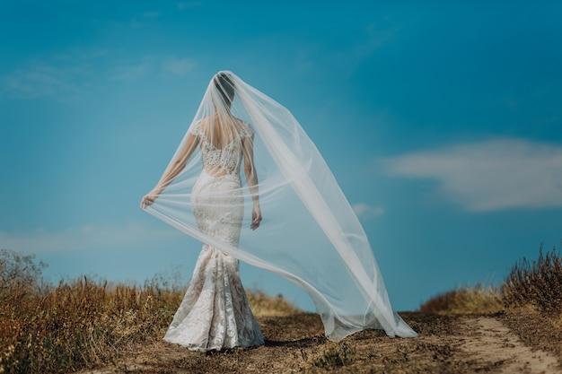 Bride in a beautiful dress highlighting figure
