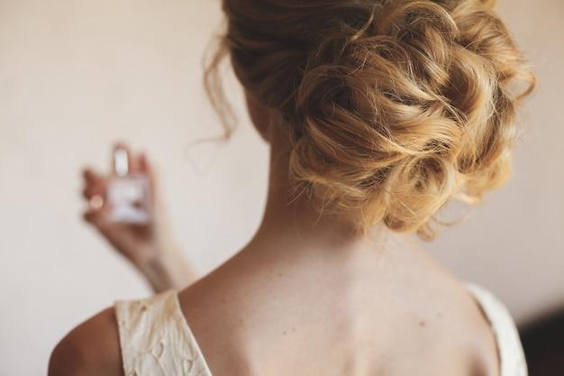 Bride blonde enjoys perfume
