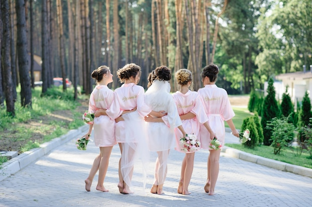 Bride and bridesmaids in the park