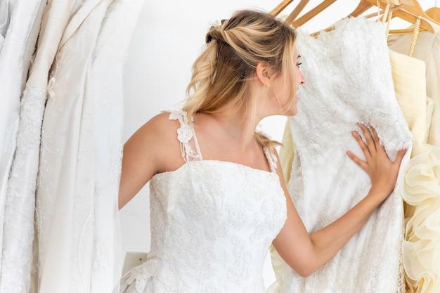 Bride caucasian play hide secretly in wedding studio.