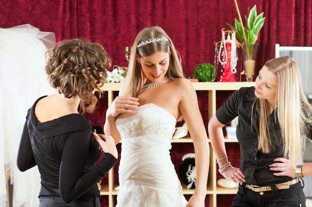 Bride at the clothes shop for wedding dresses