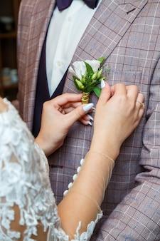 Bride cuddle with groom on wedding day