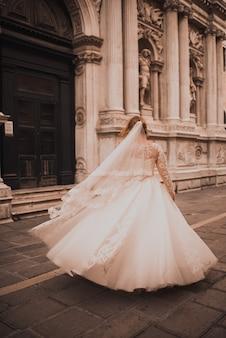 Bride dance in venezia woman whirls in white wedding dress