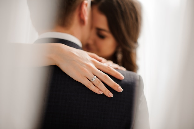 Bride demonstrates her elegant diamond engagement ring