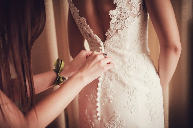 Bride in dress, preparing for the wedding.