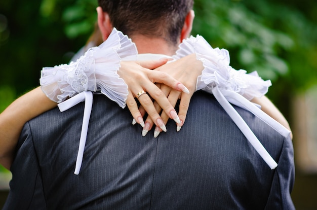 Bride embraces the groom's neck