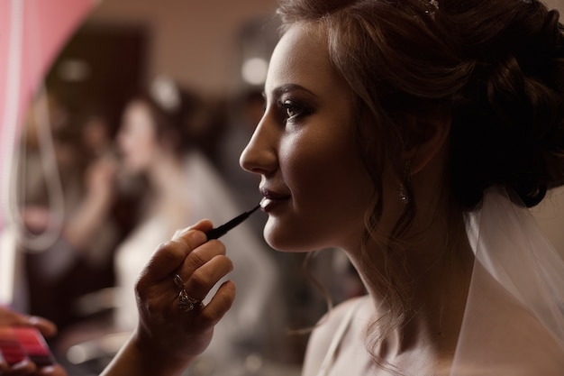 The bride at a gathering on the day of the wedding, the work of a stylist, makeup