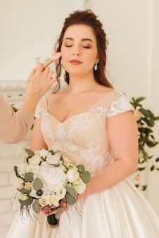 Bride getting  her make up ready