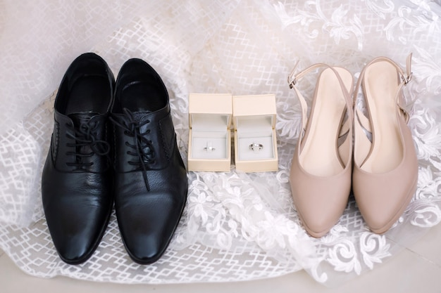 Bride and groom accessories preparation for wedding concept.