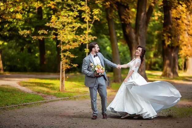 Bride and groom in autumn park