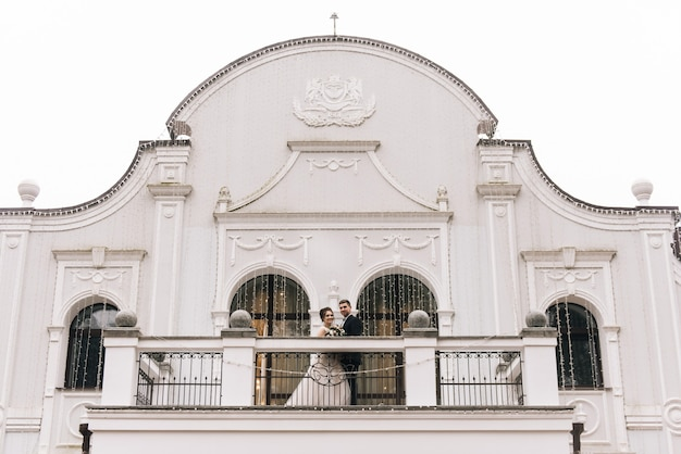Bride and groom on the balcony of a beautiful hotel