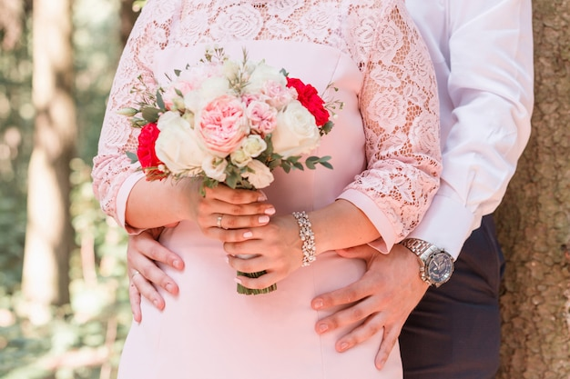 Bride and groom. bride holds a bouquet in her hands