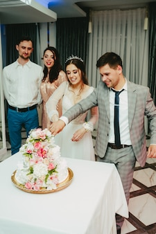 The bride and groom cut the cake