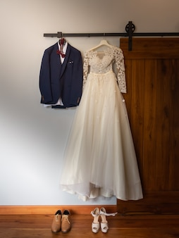 Bride and groom dress on wedding ceremony day