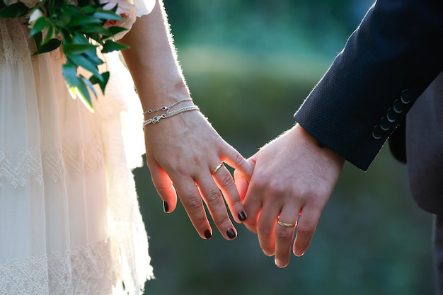 Bride and a groom holding hands