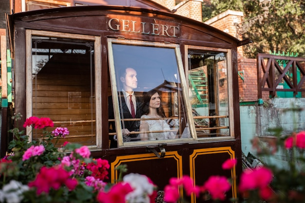 Bride and groom hugging in the cable car on the castle hill.