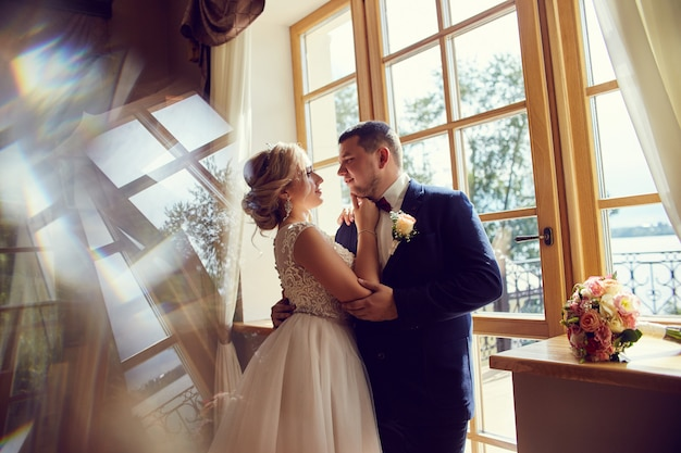 Bride and groom hugging and kissing, love forever