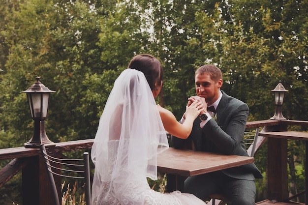 Bride and groom irish style at wedding day walking outdoors on in country village house. bridal couple happy newlywed woman and man walk in green park or forested. concept of marriage day and married