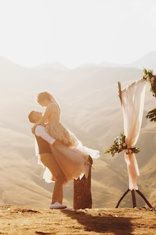 Bride and groom look lovely during the wedding ceremony on the top of the mountain