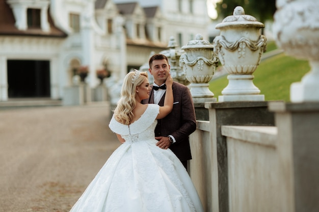 Bride and groom in park on their wedding, photo session.