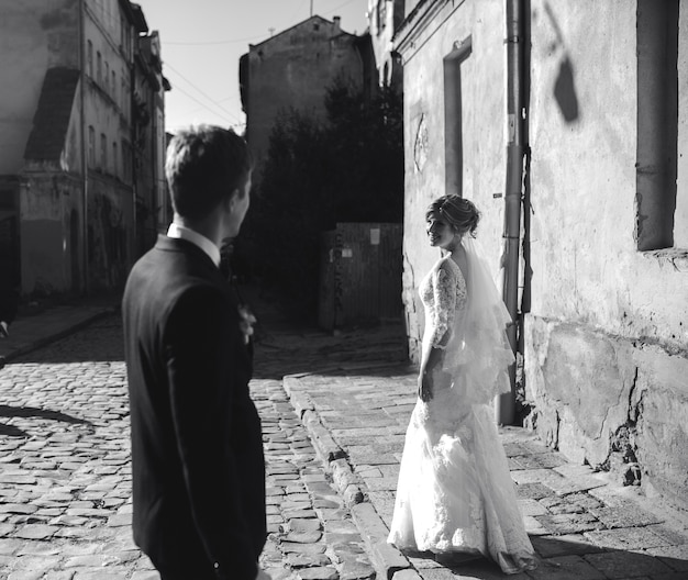 Bride and groom posing on the streets of the old town