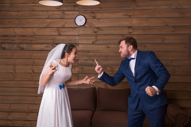 Bride and groom shouting at each other