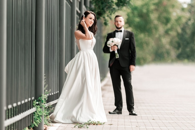 Bride and groom standing on a city street. photo with copy space