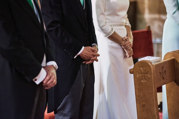 Bride and groom stayings in a church during wedding ceremony