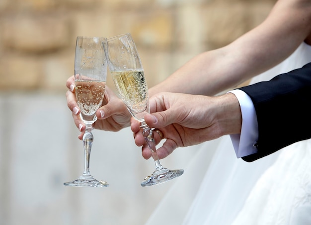 Bride and groom toasting with champagne glasses