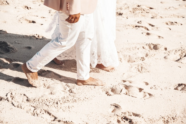 Bride and groom walking together along the beach. romantic wedding couple