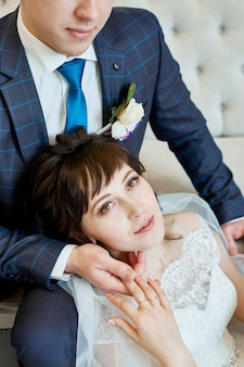 Bride and groom in wedding clothes embrace at home. couple in love after a wedding ceremony