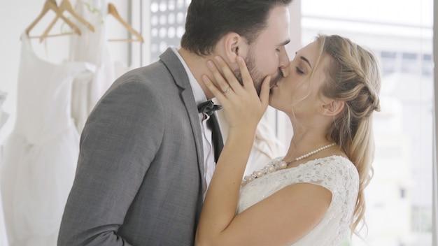 Bride and groom in wedding dress prepare ceremony.
