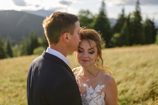 Bride and groom. wedding photo session in the mountain landscape.