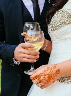Bride and groom with glasses of champagne