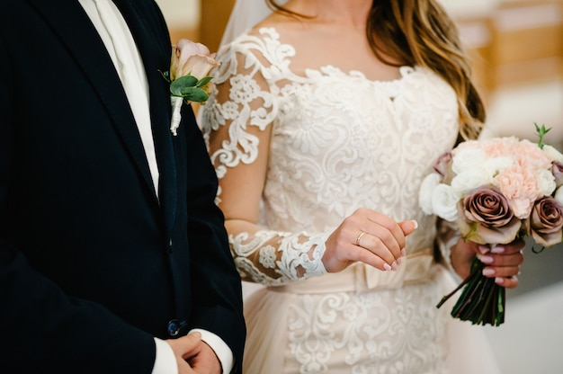 The bride and groom with a wedding bouquet