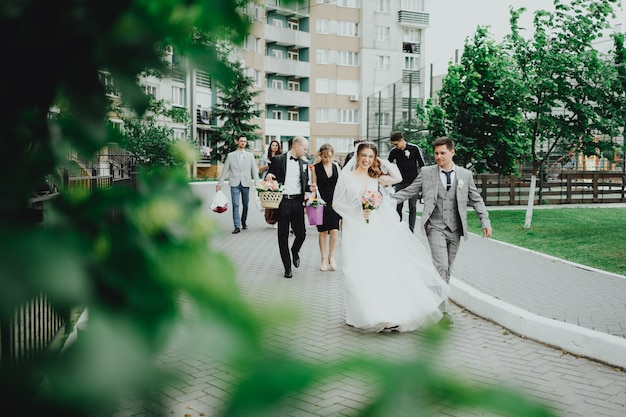 The bride and groom and the youth walk
