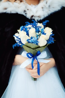 Bride holding bouquet of fresh callas lilly. creative winter wedding bouquet